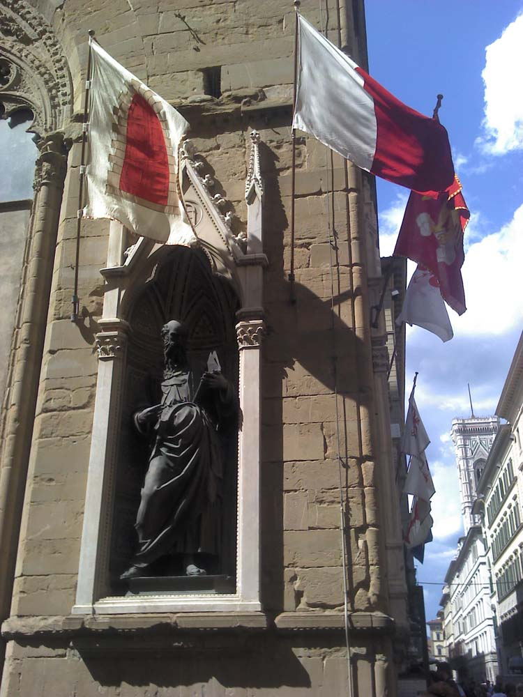 The statue of John the Evangelist, commissioned by the silk traders, symbolized by the gate they brought their goods through.